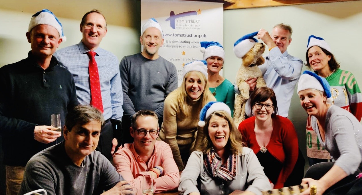 The Tom's Trust team in Christmas hats