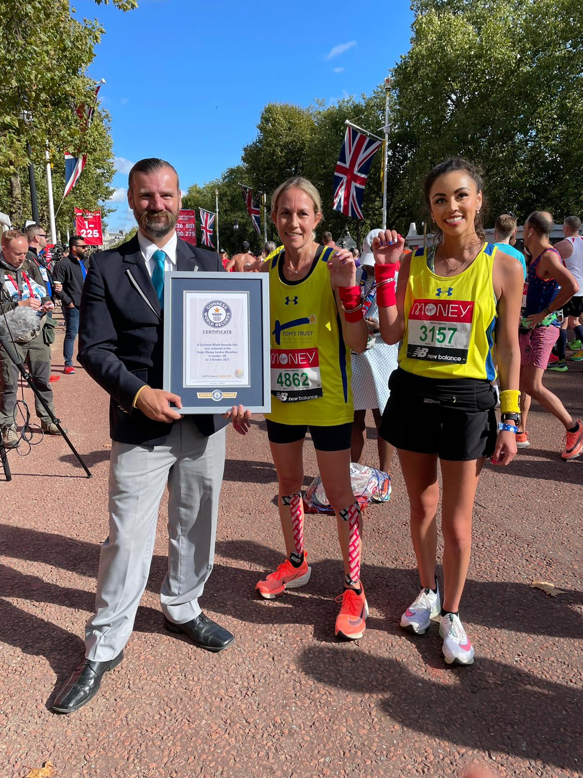 Kerry and Troi being presented with their Guinness World Record certificate